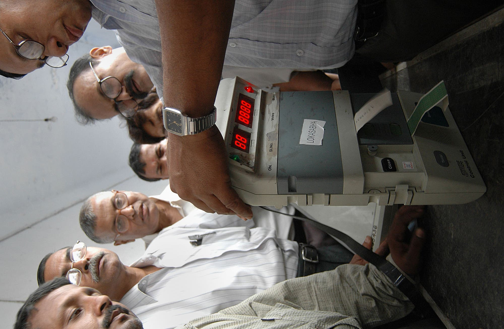 Polling officers learn to handle the EVM from experts in Gauhati, India, on March 11, 2006. (AP)