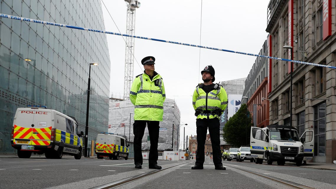 Police stand in the vicinity of Manchester arena in Manchester, Britain May 24, 2017. reuters