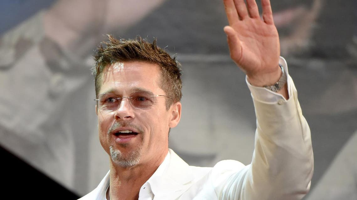 """US actor Brad Pitt waves to his fans during the Japan premiere of his latest movie """"War Machine"""" in Tokyo on May 23, 2017. The film will be released by online streaming on May 26. (AFP)"""