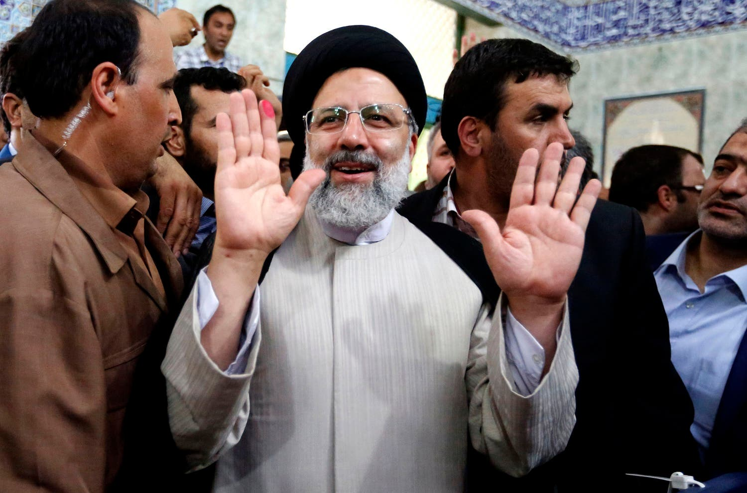 Ebrahim Raisi gestures after casting his ballot for the presidential elections in southern Tehran on May 19, 2017. (AFP)
