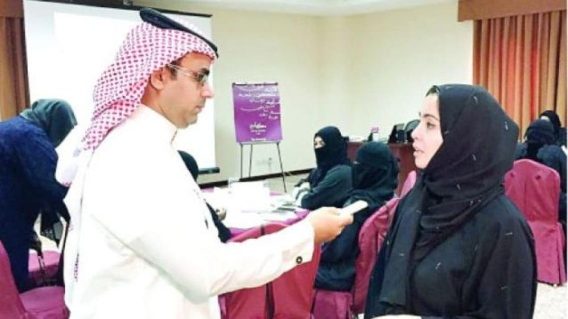Sara Qassim speaking to Faisal Al-Silmy after winning the Tourism Trainer Award. — Okaz photo