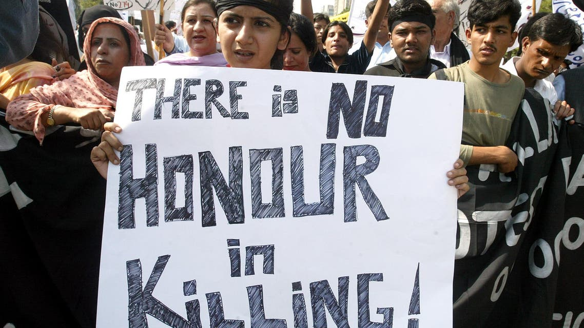 Pakistani supporters of Citizen's Action Group protest against honour killings during a demonstration in the capital Islamabad October 8, 2004. (Reuters)