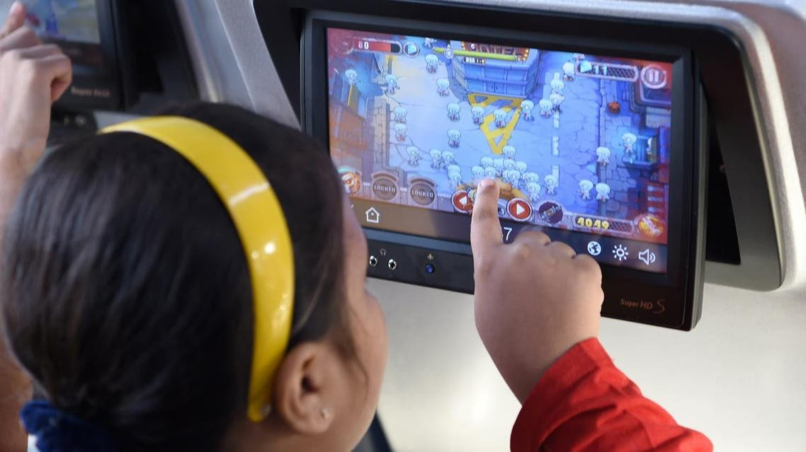 an Indian child plays a game on a touch-screen onboard the Tejas Express luxury train. (AFP)