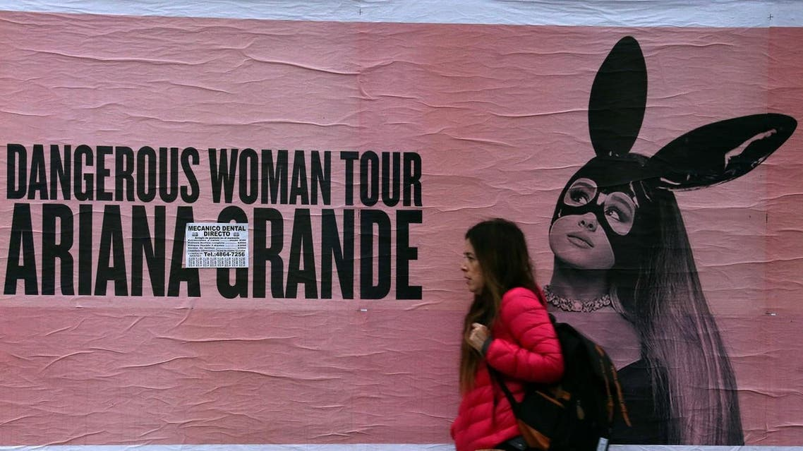 A woman walks past a billboard advertising US singer Ariana Grande's world tour in Buenos Aires, Argentina May 24, 2017. (Reuters)
