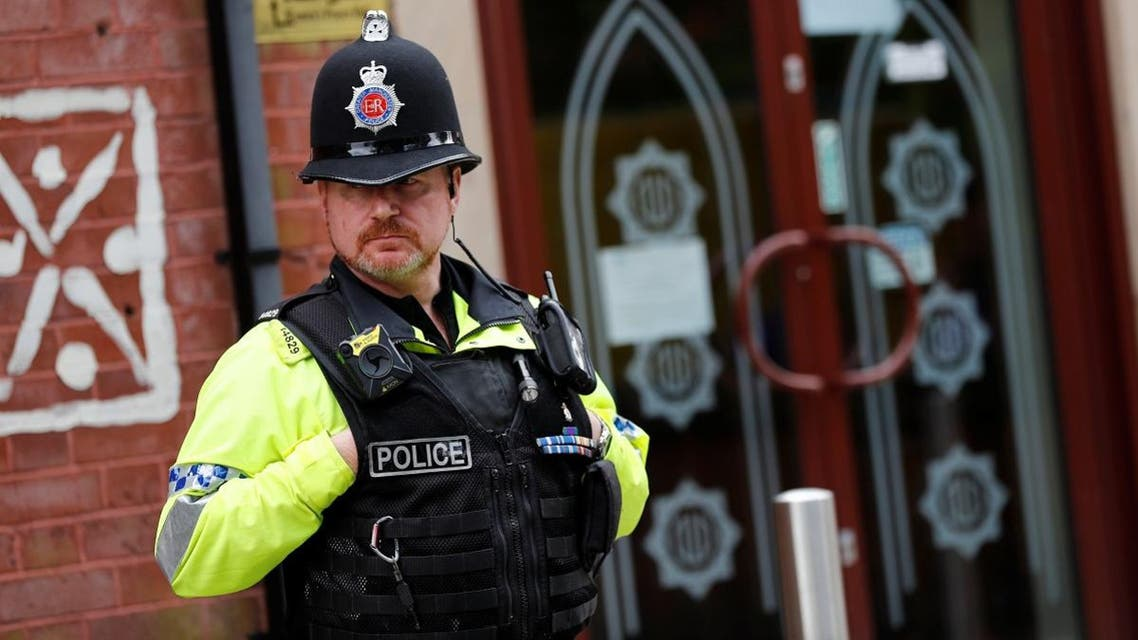 A police officer stands outside Didsbury mosque in Manchester. (Reuters)