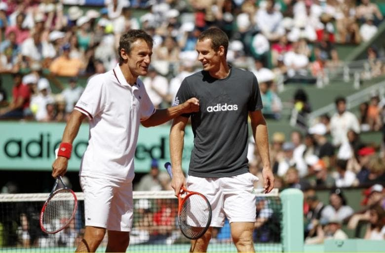 Mats Wilander of Sweden (L) and Andy Murray of Britain joke during an exhibition match held a day before the start of the French Open tennis tournament at the Roland Garros stadium in Paris May 26, 2012. (Reuters)