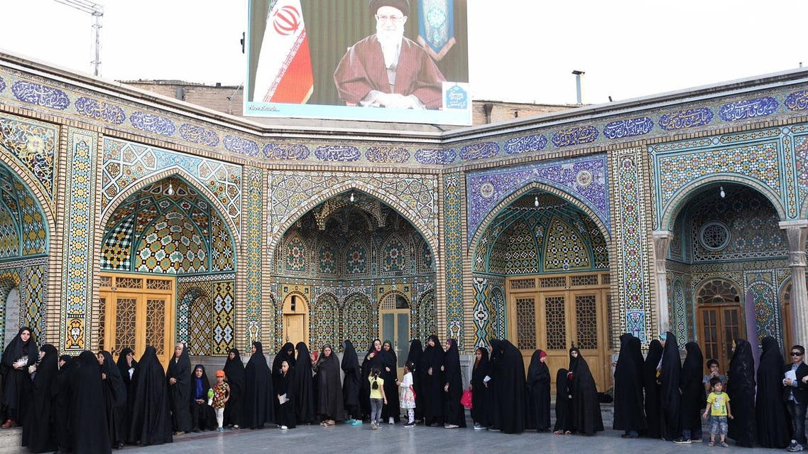 Iranian women prepare to cast their votes for municipal and presidential elections in the city of Qom, 130kms south of Tehran, on May 19, 2017. (AFP)