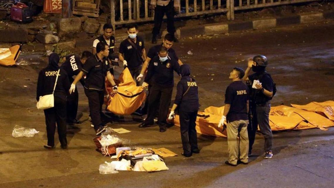 Police officers carry a body bag from the site where explosions reportedly went off near a bus terminal in Jakarta, Indonesia, Thursday, May 25, 2017. A suspected suicide bombing near a bus terminal in Indonesia's capital Wednesday night killed a policeman and injured nine other people, including four officers, police said. (AP Photo