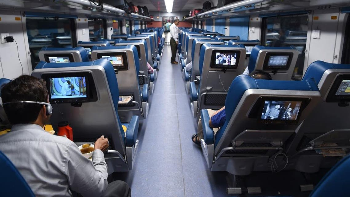 In this photograph taken on May 22, 2017, Indian passengers travel onboard the Tejas Express luxury train during its first journey between Mumbai and Goa in Mumbai. (AFP)