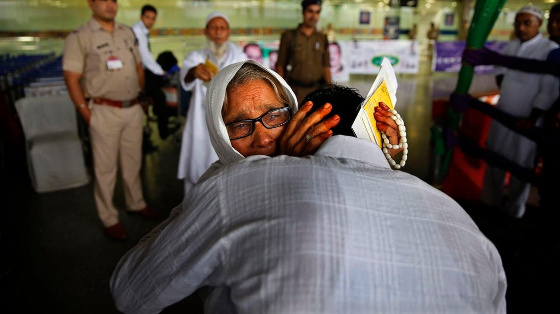 An Indian Muslim woman pilgrim cries as she hugs her son at the airport before leaving for Hajj in New Delhi on Sept. 3, 2014. (AP)