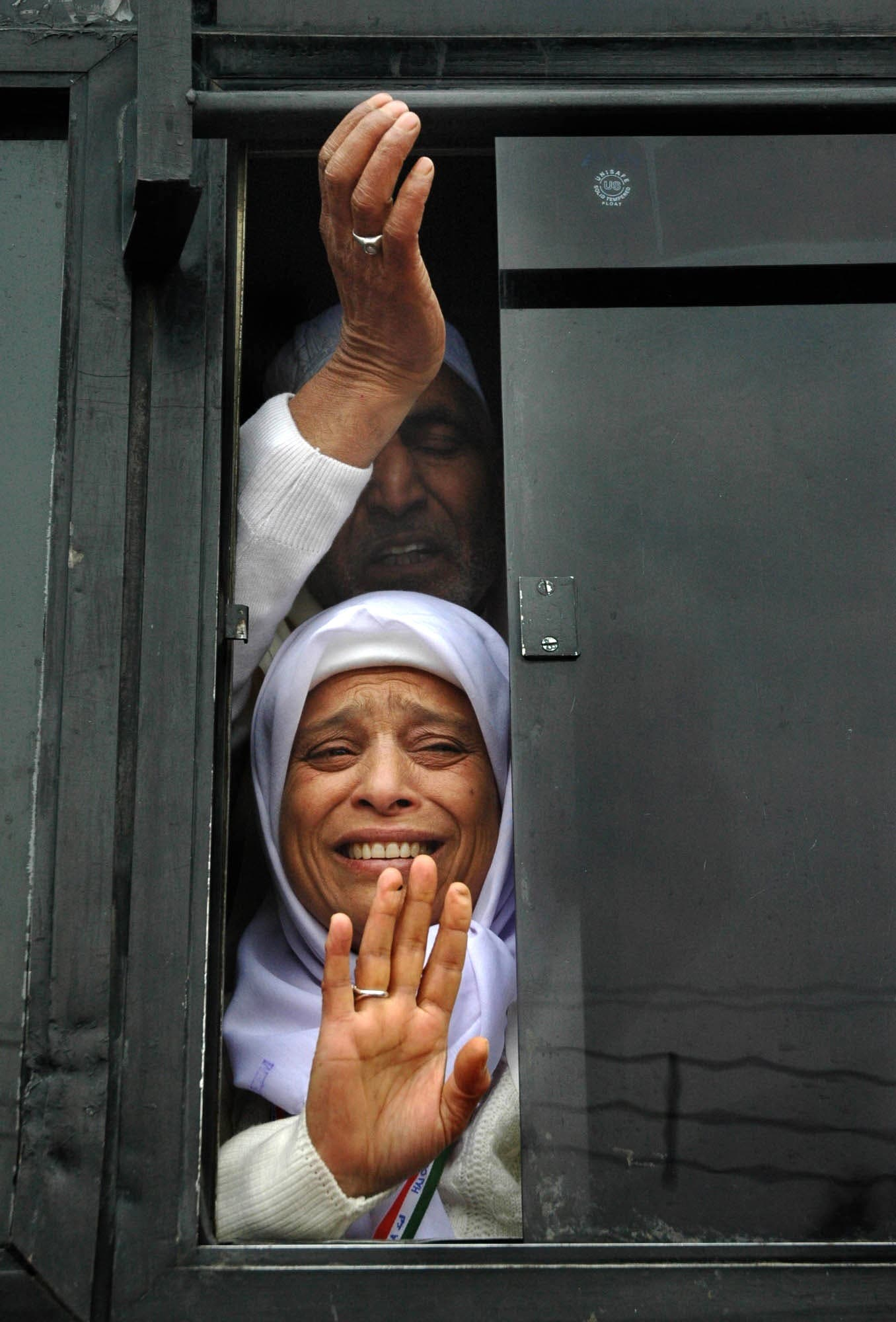 Kashmiri Muslim pilgrims wave as they leave for Hajj in Srinagar, India, on Dec. 3, 2005. (AP)