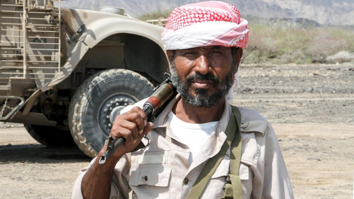A Yemeni fighter loyal to the Saudi-backed Yemeni president poses for a picture in a mountainous region northwest of Taiz, on April 20, 2017. (AFP)