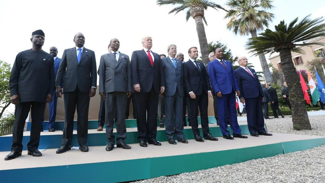 US President Donald Trump poses with G7 leaders and leaders of African nations during a family photo at the G7 Summit expanded session in Taormina. (Reuters)