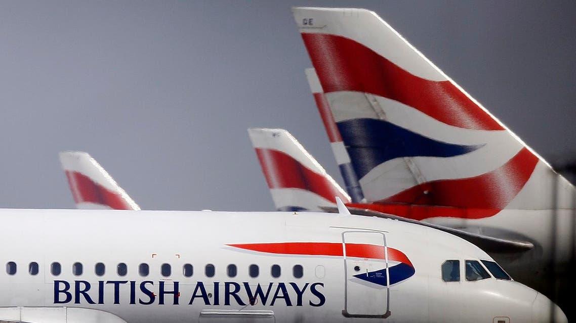 British Airways planes are seen behind fencing at Heathrow airport in London. (AP)