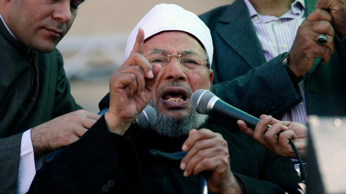 Egyptian cleric Sheik Youssef el-Qaradawi, who resides in Doha, speaks to the crowd as he leads Friday prayers in Tahrir Square in Cairo in 2011. (File photo: AP)