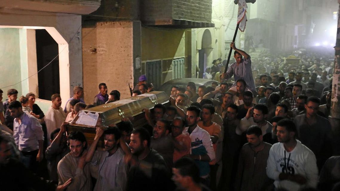 Mourners carry crosses and march at the funeral of Coptic Christians who were killed on Friday in Minya. (Reuters)