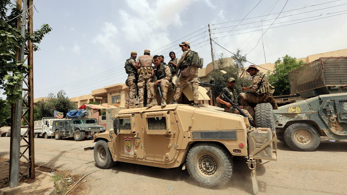 Members of Iraqi rapid response force ride in a military vehicle during a battle against Islamic State militants in Mosul, Iraq May 20, 2017.