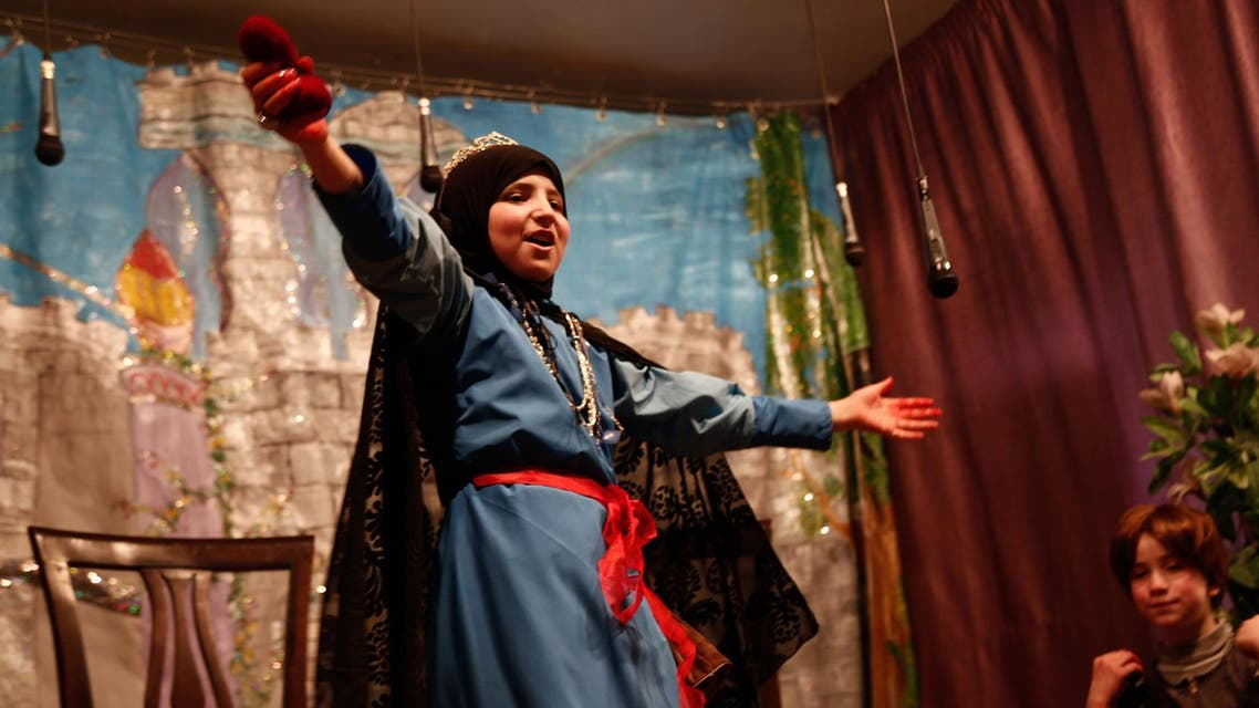 Syrian refugees snow white play, AFP