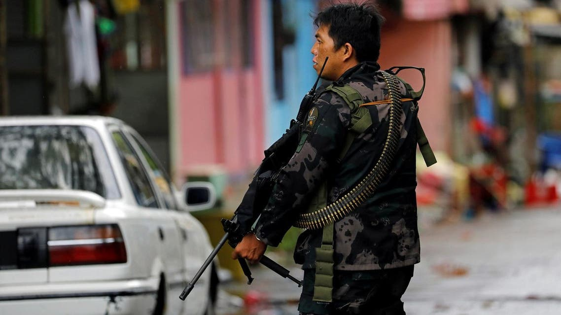 A government soldier takes up position during a patrol along a deserted street in Marawi City, southern Philippines, on May 27, 2017. (Reuters)