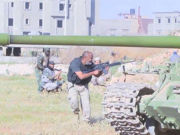 """من هي الجماعات المقاتلة في ليبيا وما صلتها بـ""""بلحاج"""""""
