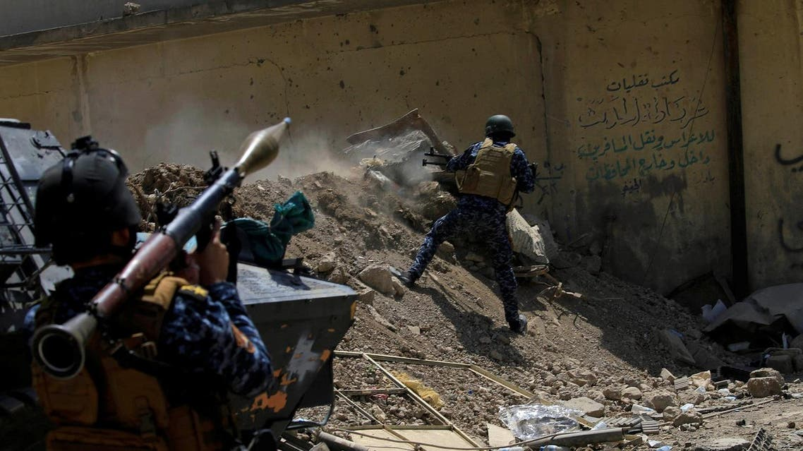 An Iraqi Federal Police member fires towards ISIS militants during a battle in western Mosul, on May 28, 2017. (Reuters)