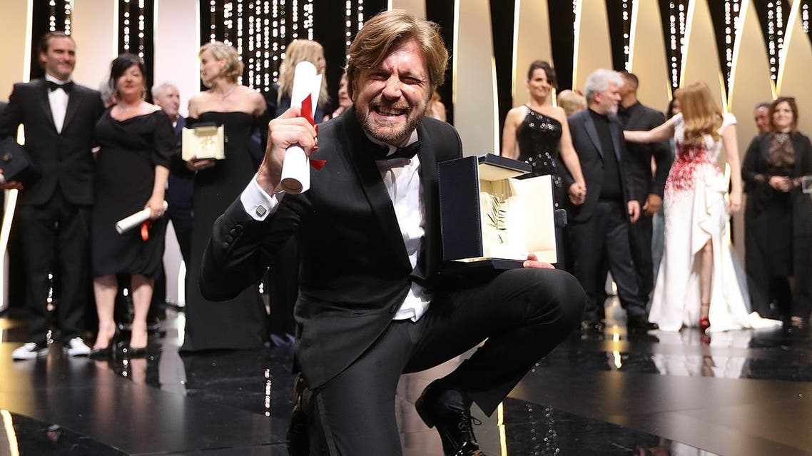 Swedish director Ruben Ostlund poses on stage with his trophy after he won the Palme d'Or for his film 'The Square' on May 28, 2017 during the closing ceremony of the 70th edition of the Cannes Film Festival in Cannes, southern France. (AFP)