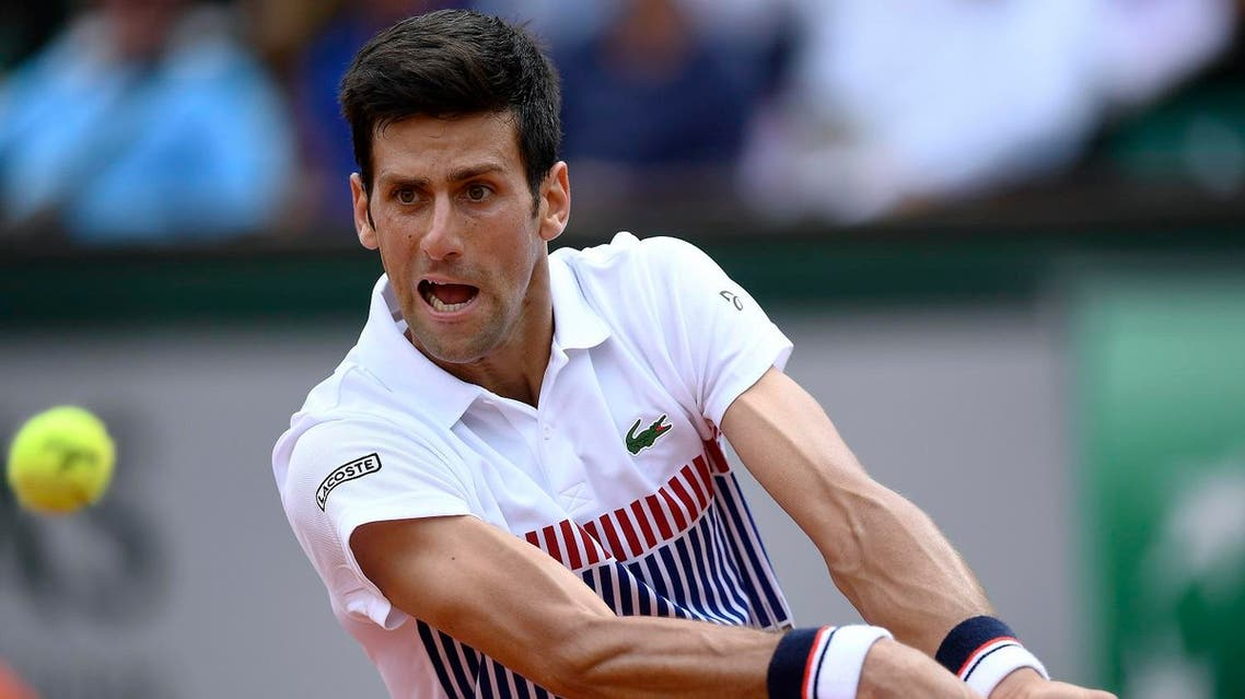 Serbia's Novak Djokovic returns the ball to Spain's Marcel Granollers during their tennis match at the Roland Garros 2017 French Open on May 29, 2017 in Paris. AFP