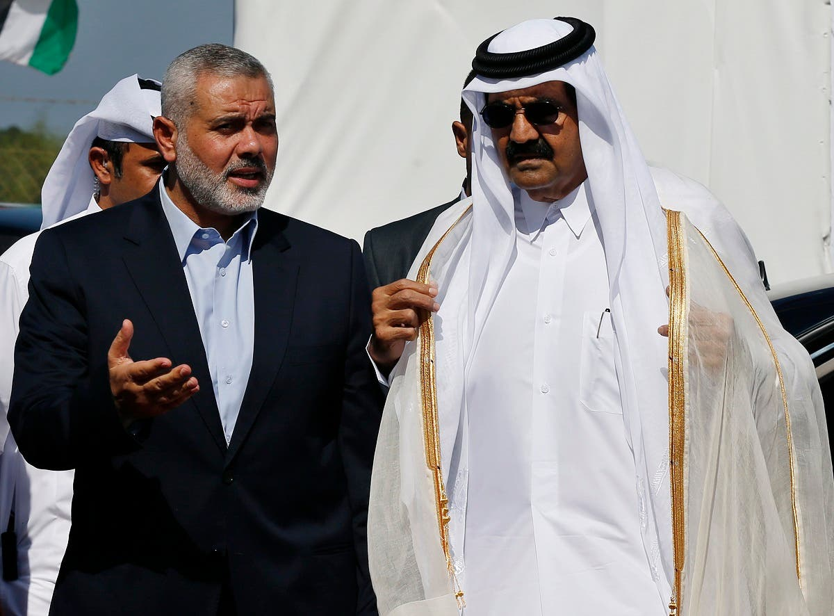 Hamas leader Ismail Haniyeh (L) and then Emir of Qatar Sheikh Hamad bin Khalifa al-Thani arrive at a cornerstone laying ceremony for a residential neighborhood in Gaza Strip on October 23, 2012. (Reuters)
