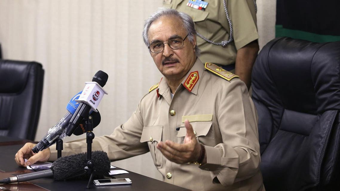 Then-General Khalifa Haftar speaks during a news conference in Abyar, east of Benghazi May 31, 2014. Growing frustration over the reality of life in eastern Libya, which contrasts with the promises of politicians, is feeding support for Haftar, who has set himself up as a warrior against Islamist militancy and who some also see as their saviour. Picture taken May 31, 2014. REUTERS/Esam Omran Al-Fetori (LIBYA - Tags: CIVIL UNREST POLITICS MILITARY)