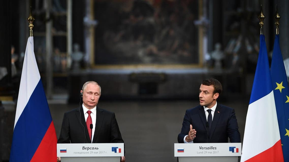French President Emmanuel Macron (R) delivers a joint press conference with Russian President Vladimir Putin (L) following their meeting at the Versailles Palace, near Paris, on May 29, 2017. French President Emmanuel Macron hosts Russian counterpart Vladimir Putin in their first meeting since he came to office with differences on Ukraine and Syria clearly visible. (AFP)