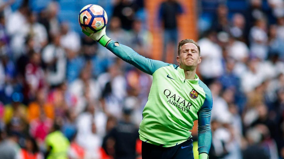 Barcelona's German goalkeeper Marc-Andre Ter Stegen warms up before the Spanish league football match Real Madrid CF vs FC Barcelona at the Santiago Bernabeu stadium in Madrid on April 23, 2017. (AFP)