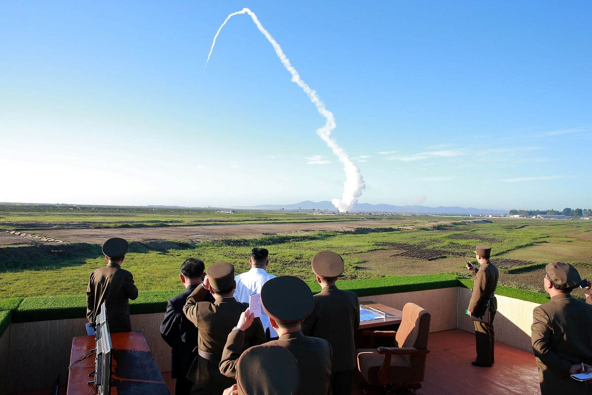 North Korean leader Kim Jong Un watches the test of a new-type anti-aircraft guided weapon system organised by the Academy of National Defence Science in this undated photo released by North Korea's Korean Central News Agency (KCNA) May 28, 2017. (KCNA via Reuters)
