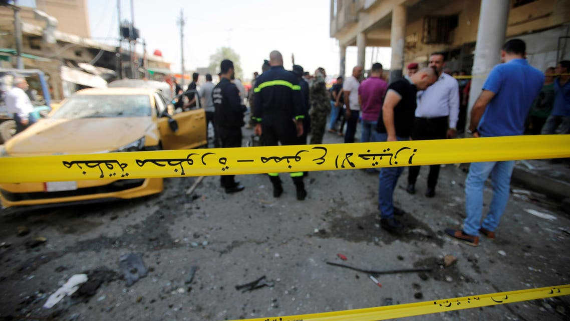 People gather at the site of car bomb attack near a government office in Karkh district in Baghdad, Iraq May 30, 2017
