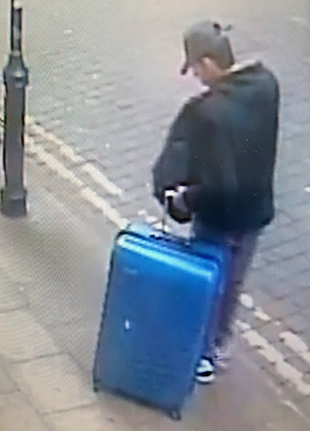 A handout CCTV photograph released by Greater Manchester Police on May 29, 2017, shows Salman Abedi with a blue suitcase in the center of Manchester on the day he committed the attack on the Manchester Arena on May 22, 2017 that killed 22 people. (AFP)