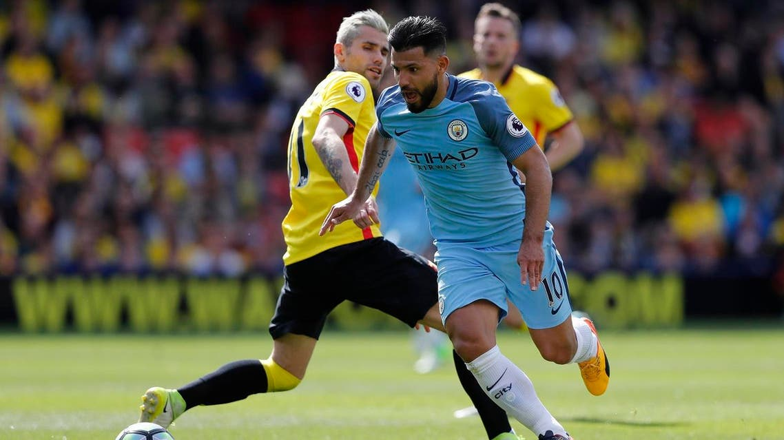 Manchester City's Argentinian striker Sergio Aguero vies with Watford's Yugoslavian-born Swiss midfielder Valon Behrami during the English Premier League football match between Watford and Manchester City at Vicarage Road Stadium in Watford, north of London on May 21, 2017. (AFP)