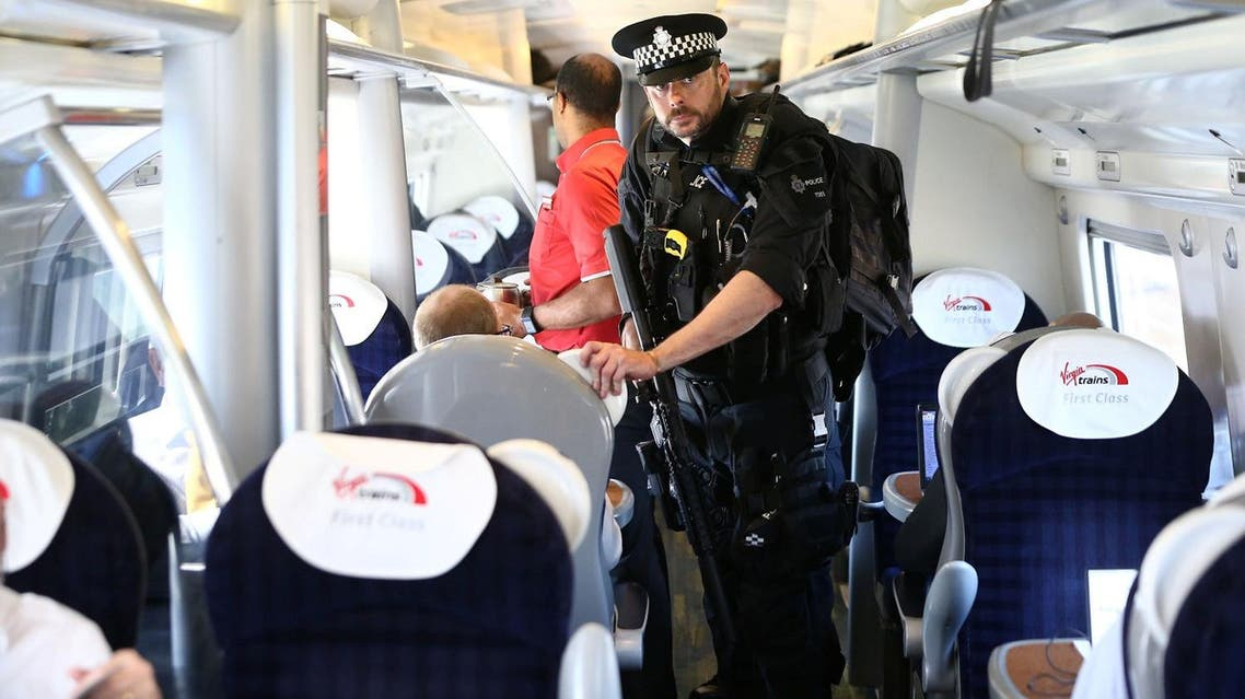 Armed police officers walk along the aisle of a train at Milton Keynes station, Britain May 25, 2017. (Reuters)