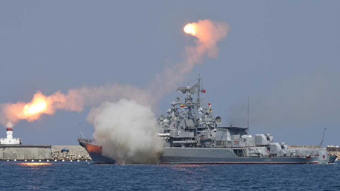 A Russian warship fires during celebrations for Navy Day in the Black Sea port of Sevastopol, Crimea, July 26, 2015. (Reuters)
