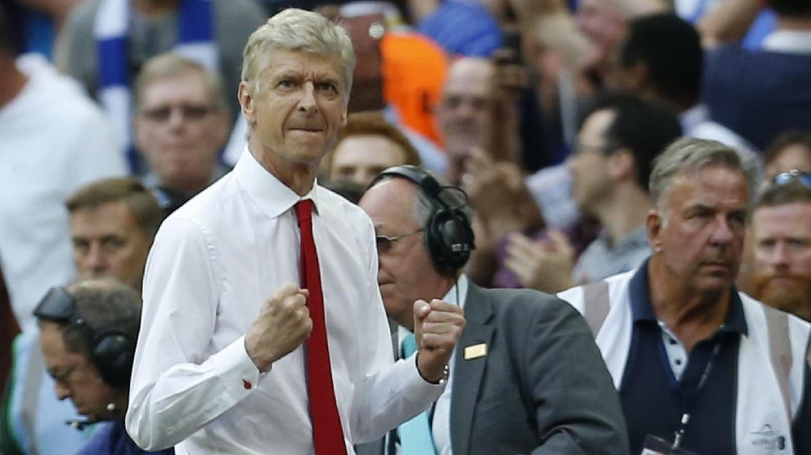 Arsenal's French manager Arsene Wenger celebrates at the final whistle in the English FA Cup final football match between Arsenal and Chelsea at Wembley stadium in London. Arsene Wenger has told Arsenal owner Stan Kroenke he will accept the Premier League club's offer of a new two-year contract, according to reports on May 30, 2017. (AFP)