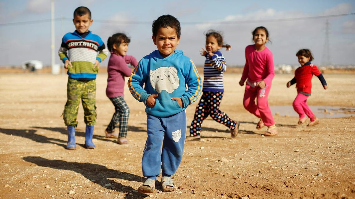 Syrian refugee children play at Al Zaatari refugee camp in Jordan near the border with Syria, December 3, 2016. (Reuters)