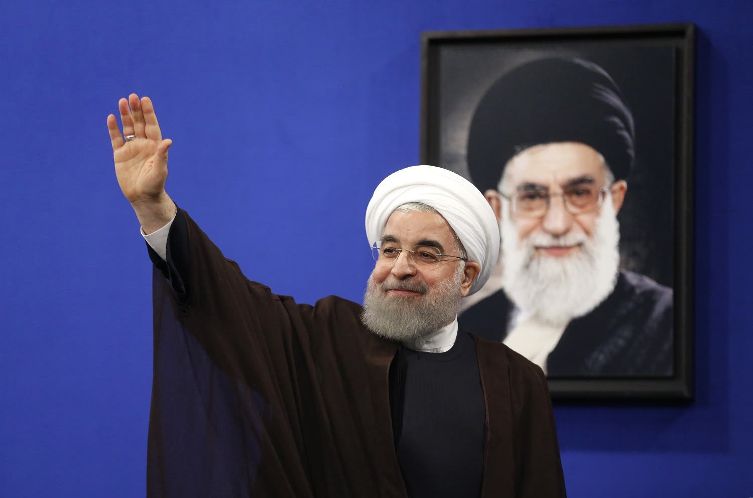 Newly re-elected Iranian President Hassan Rouhani gestures after delivering a televised speech in the capital Tehran on May 20, 2017. (AFP)