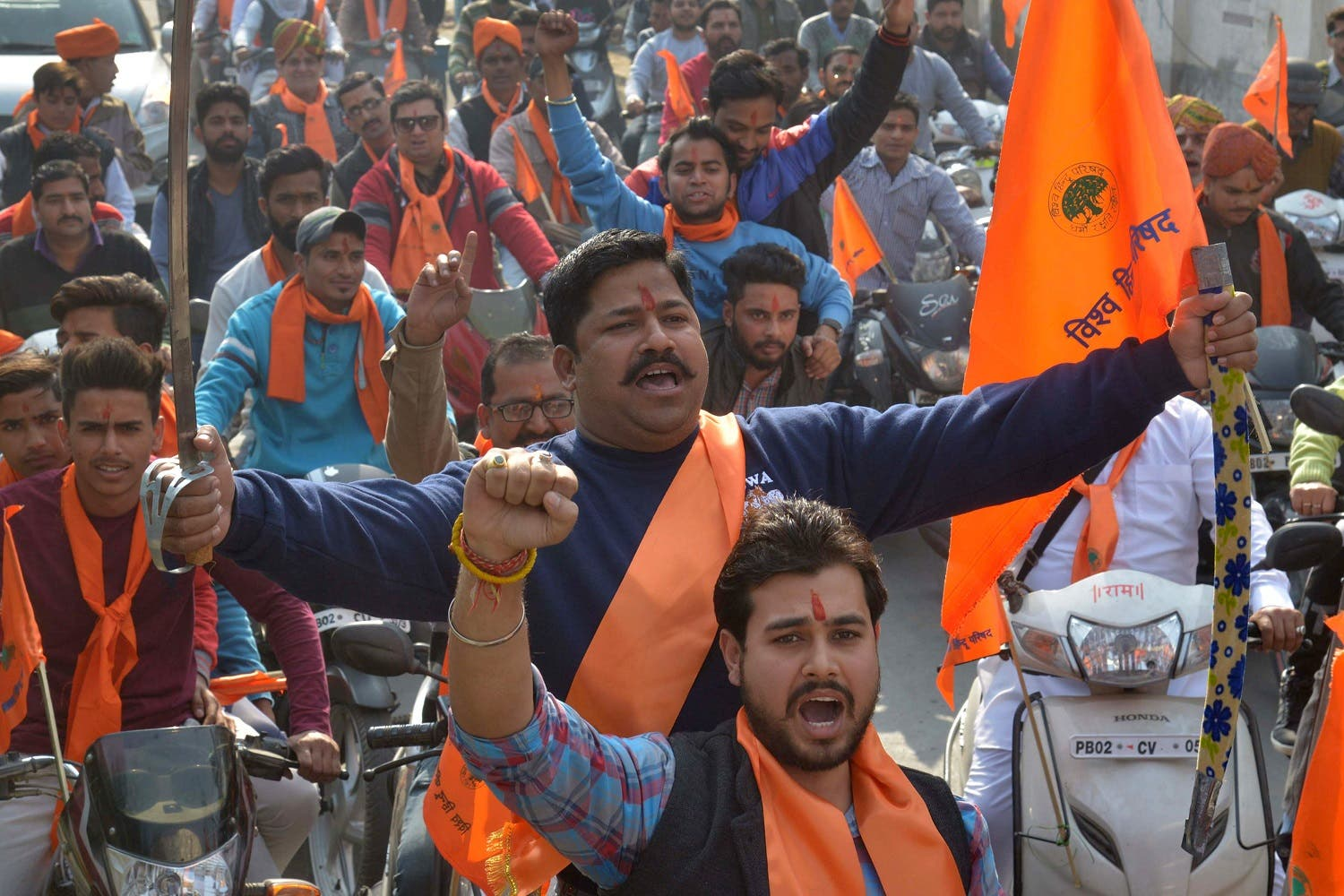 Indian activists of Hindu Bajrang Dal, along with the Vishva Hindu Parishad (VHP), raise religious slogans during a procession marking the 24th anniversary of the demolition of the Babri Masjid Mosque in Ayodhya, in Amritsar on December 6, 2016. (AFP)