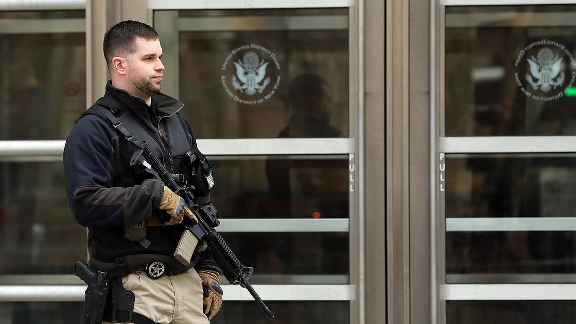 An armed U.S. Marshal stands outside of a U.S. Federal court during the arraignment of Tairod Pugh, a former U.S. Air Force mechanic accused of attempting to join the terrorist organization ISIS, on March 18, 2015 in New York City. (AFP)