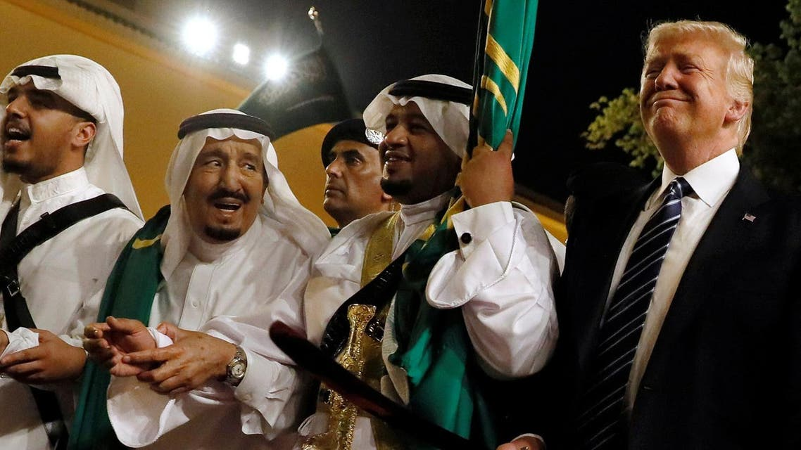 Saudi Arabia's King Salman bin Abdulaziz Al Saud (2nd L) welcomes U.S. President Donald Trump to dance with a sword during a welcome ceremony at Al Murabba Palace in Riyadh, Saudi Arabia May 20, 2017. (Reuters)