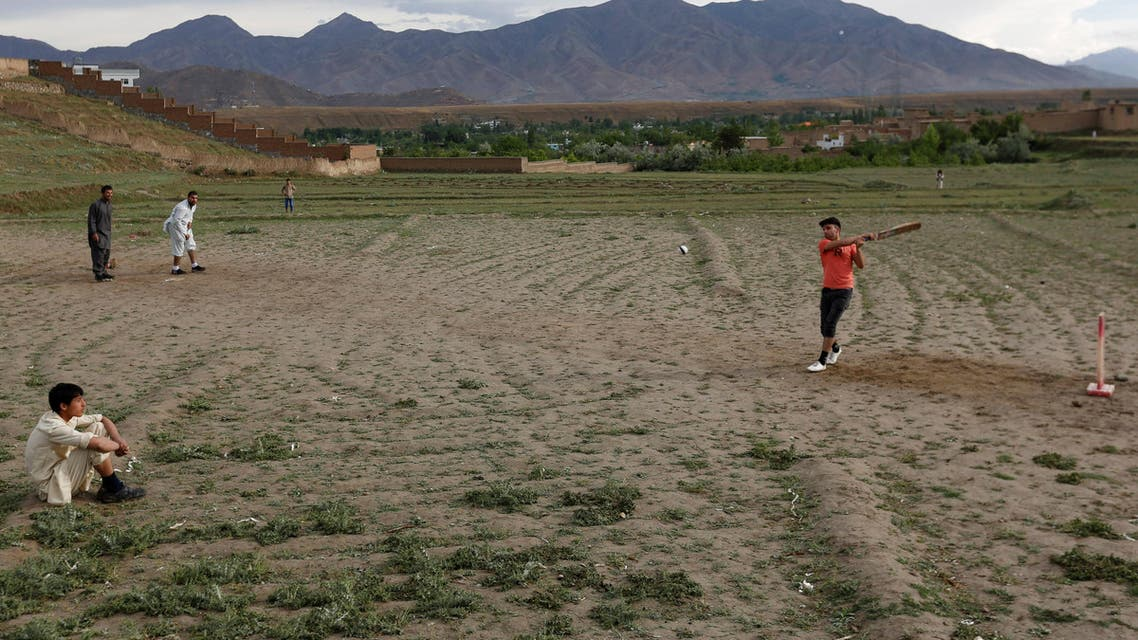Afghan men play cricket on outskirt of Kabul, Afghanistan May 15, 2017. REUTERS
