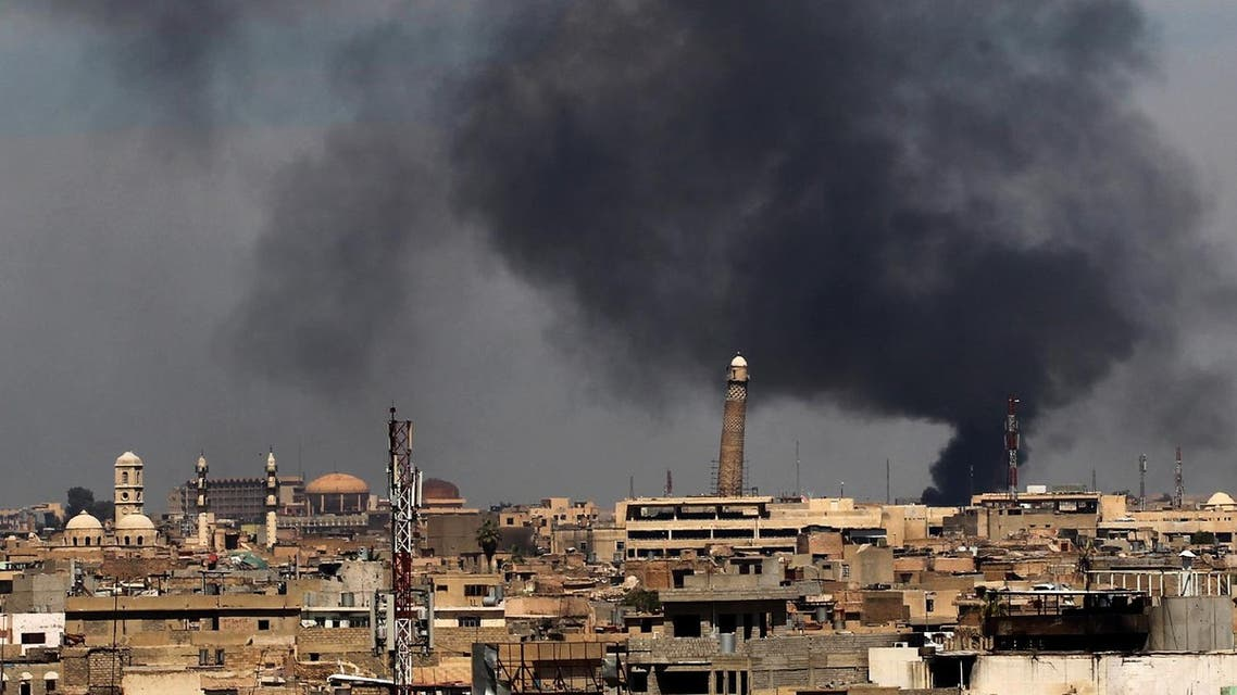 Smoke billows from behind the Great Mosque of al-Nuri in Mosul's Old City on April 17, 2017, during an offensive by Iraqi security forces to recapture the city from ISIS militants. (AFP)