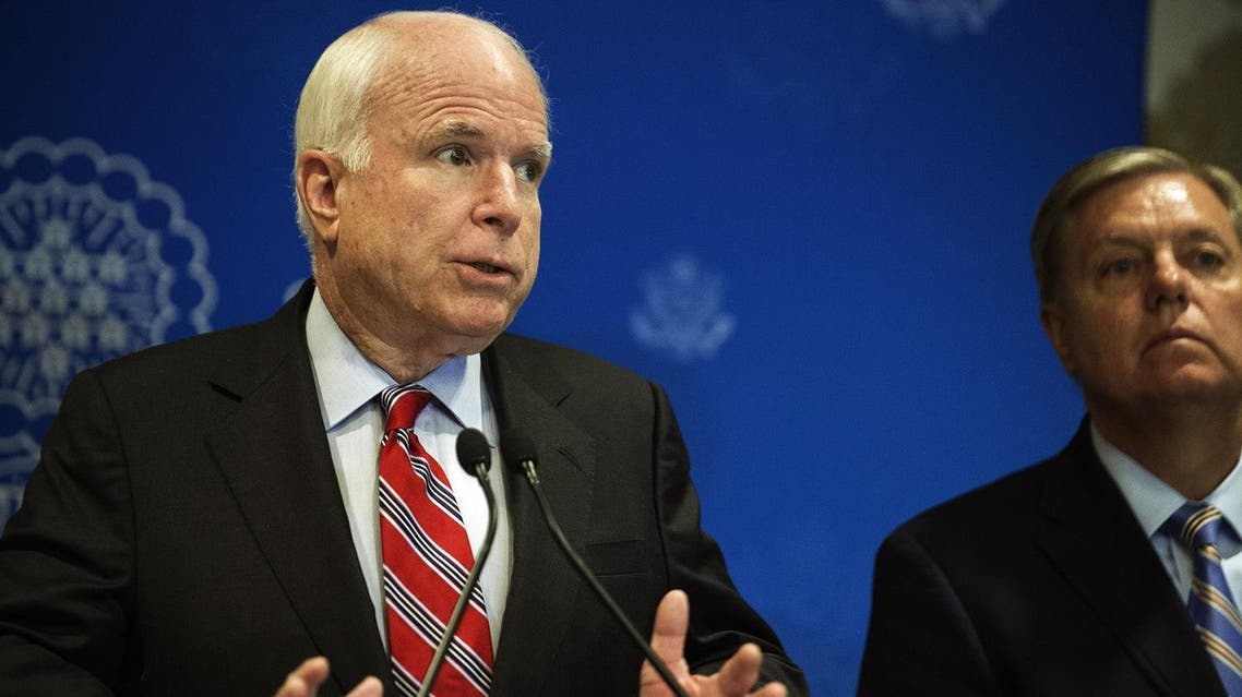 John McCain and Lindsey Graham address a news conference on August 6, 2013 in Cairo, Egypt. (AFP)