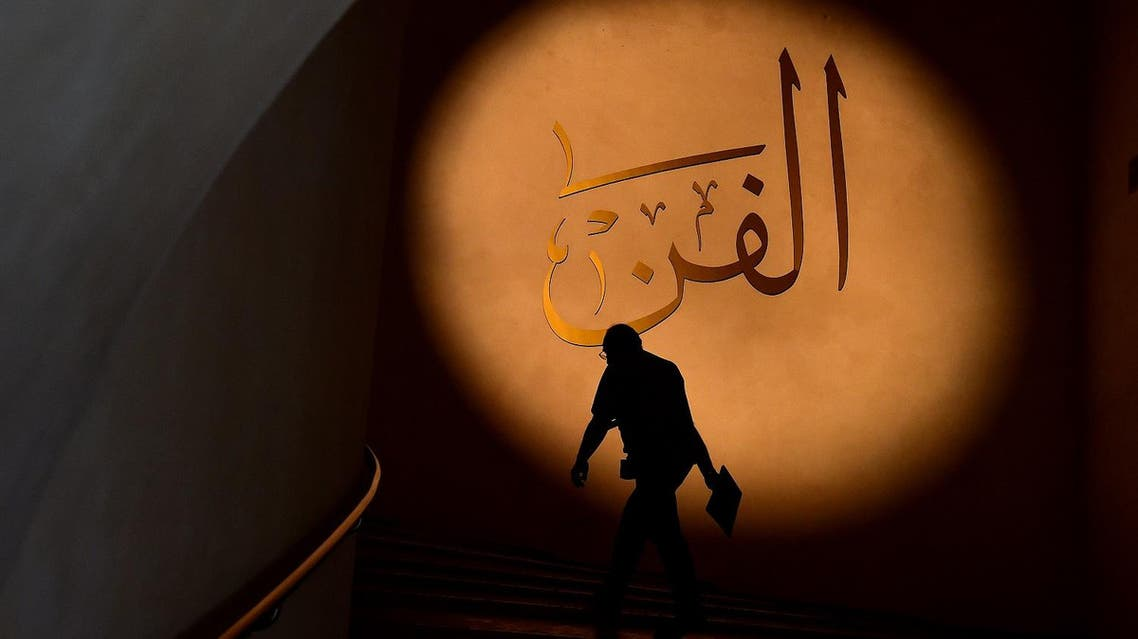 """A visitor arrives at the exhibition """"Art of the Islamic Civilization: The al-Sabah Collection"""" at the Scuderie del Quirinale museum in Rome on July 24, 2015. (AFP)"""