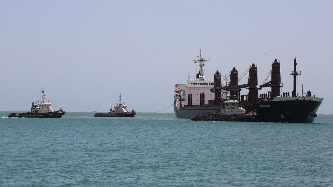 Tugboats are seen near a ship in the Red Sea port of Hudaydah, Yemen. (Reuters)