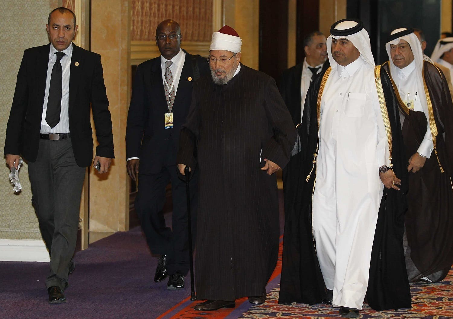 Yusuf al-Qaradawi arrives at the opening of the International Conference on Jerusalem in Doha on February 26, 2012. (AFP)