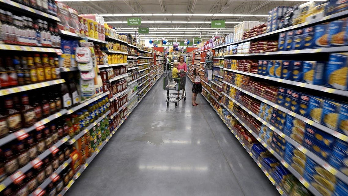 A family shops at the Wal-Mart Neighborhood Market in Bentonville, Arkansas, US on June 4, 2015. (Reuters)